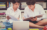Two schoolboys in the library