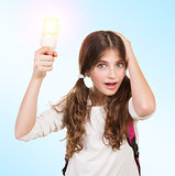 Shocked schoolgirl with lamp