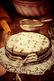 White and chocolate Christmas cake in vintage look