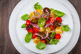 Tomato salad with onions and basil