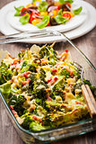 Baked broccoli with tomato salad