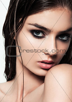 Beautiful woman with make up and wet hair on white background