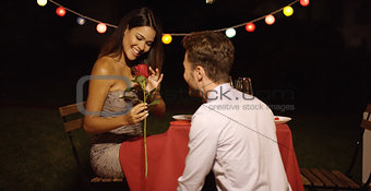 Young man giving a beautiful woman  rose