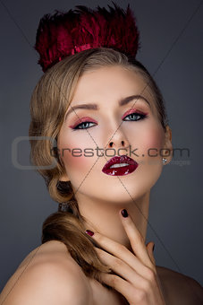 Beautiful girl with red makeup