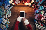 Santa using a digital tablet