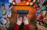 Santa typing on a laptop