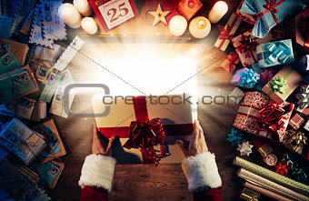 Santa opening a gift box