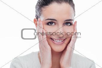 Beautiful young model touching her skin