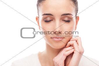 Beautiful woman touching her smooth skin