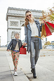 happy mother and daughter near Arc de Triomphe going forward