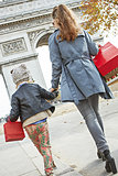 young mother and child shopper in Paris, France walking