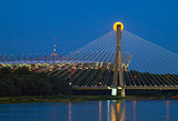 Warsaw, Poland - July 20, 2016: Panoramic view of the rising fullmoon over the National Stadium and Swietokrzyski Bridge in Polish Capital.