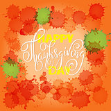 Happy Thanksgiving Day lettering. Vector illustration. Watercolor colorful drops. Autumn orange background. EPS 10