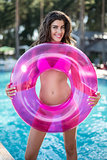 Girl in swimsuit with rubber ring
