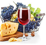 Goblet red wine with blue grapes in