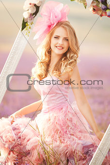Beautiful young woman in the lavender fields.