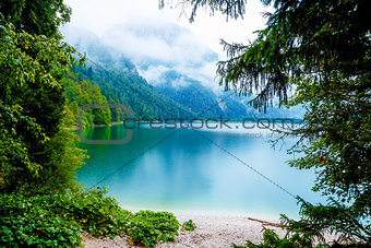 Beautiful landscape, lake with mountain in summer rain.