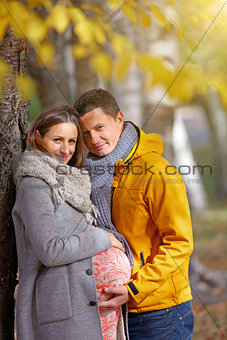 Pregnant woman in the autumn