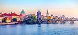 Sunset landscape view to Charles bridge on Vltava river in Prague