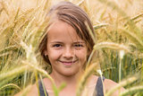 Summer portrait of a young girl in the wheat field