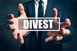 Divest concept with businessman in suit