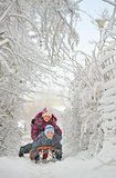 Two cute kids riding sled