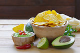 dip of avocado guacamole and corn chips, Mexican food