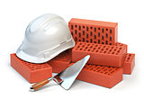 Hardhat,  bricks and trowel  isolated on white. Costruction conc