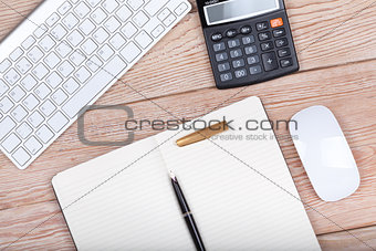 Business concept photo: keyboard, calculator, paper, ink pen