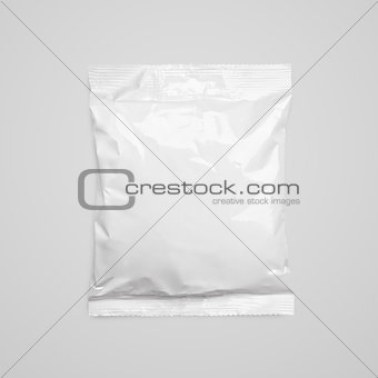 Top view of blank plastic pouch food packaging on gray