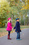 Happy Kids in Autumn Park