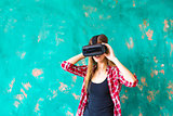 technology, VR, entertainment and people concept - happy young woman with virtual reality headset or 3d glasses