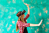 Woman touching something using virtual reality headset glasses