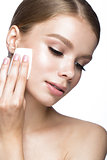Beautiful young girl with wipes for removing makeup and French manicure. Beauty face.