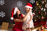 Happy mother and small girl with Christmas decoration around