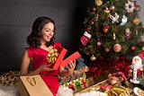 Woman opening a gift box.Christmas season.