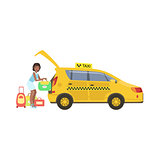 Woman Putting Her Luggage In The Trunk Of Yellow Taxi Car