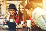 Group of girls friends coffee tablet