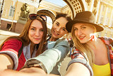 Group of girls friends taking happy selfie