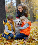 Kid and dog in autumn park