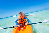 Kids paddling in kayak