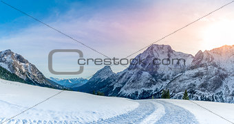 Alpine panorama with  snowy road