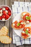 Bruschetta with cherry tomatoes and mozzarella