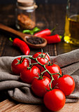 Fresh tomatoes with red and black pepper on kitchen towel