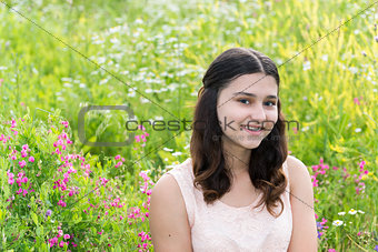 Portrait of Pretty teen girl outdoors in summer