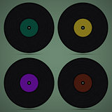 Four records on green background