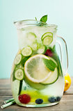 Infused water with cucumber, lemon, lime, berry and mint