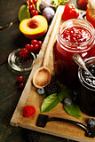 Fruit and berry jam on a wooden background