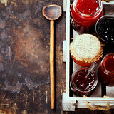 Fruit and berry jam on a rustic background