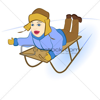 boy sledding down the hills